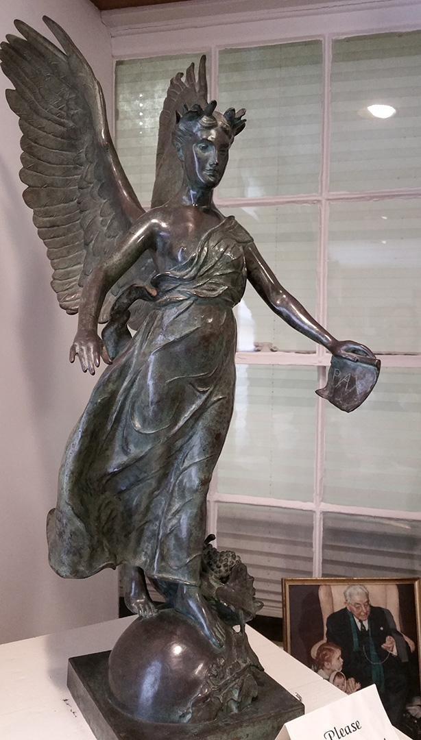 Winged Woman bronze sculpture at the Clinton County History Center