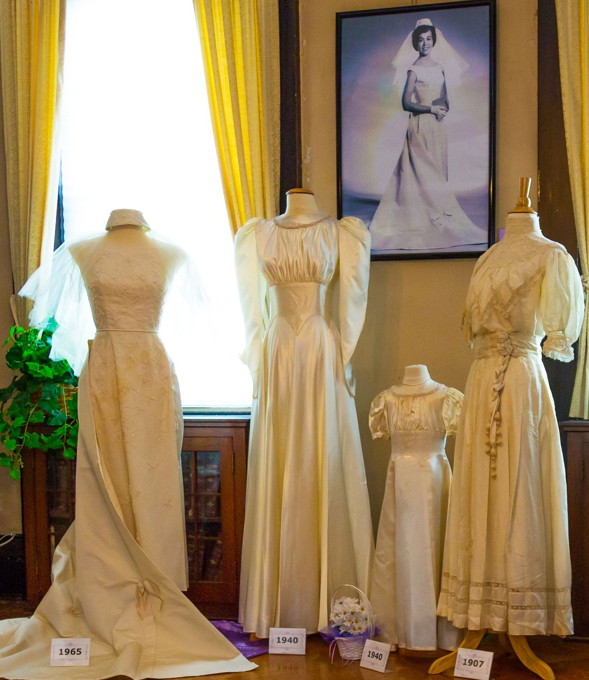 beautiful antique bridal gowns on mannequins